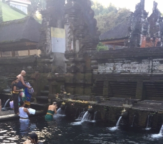 Bathing in the Pools and Fountains at Pura Padang Temple
